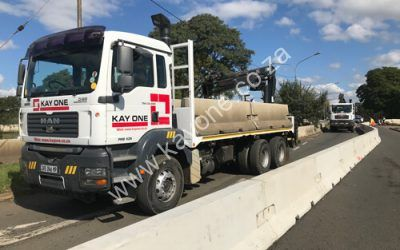 Kay One Industries trucks in action
